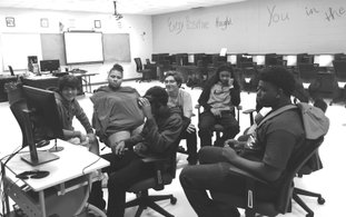 Preparing: Strong High School students Caleb Franklin, Marshay Wayne, Reese Ballard, Amaya Smith and Tyrese Rogers observe as Jamyron Thompson uses virtual reality equipment. Thompson, a sophomore, uses the Oculus Rift in Tina Raney's Marketing class. Students will create a marketing plan based on an application on the VR system during this grading period.