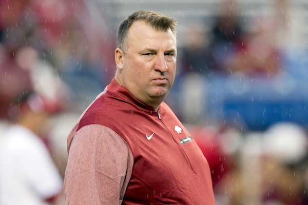 Arkansas head coach Bret Bielema walks across the field before the first quarter of an NCAA college football game against Florida A&M on Thursday, Aug. 31, 2017, in Little Rock, Ark.. (AP Photo/Gareth Patterson)