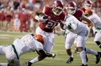 Arkansas running back Devwah Whaley, 21, scores a touchdown during the second quarter of an NCAA college football game against Florida A&M on Thursday, Aug. 31, 2017, in Little Rock, Ark. Arkansas went on to beat Florida A&M 49-7. (AP Photo/Gareth Patterson)