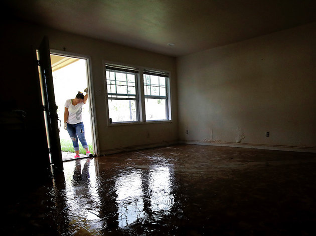 file-in-this-aug-31-2017-file-photo-alejandra-castillo-takes-a-break-from-carrying-water-soaked-items-out-of-her-familys-home-after-flood-waters-receded-in-houston-experts-say-harveys-filthy-floodwaters-pose-significant-dangers-to-human-safety-and-the-environment-that-will-remain-even-after-levels-drop-far-enough-that-southeastern-texas-residents-no-longer-fear-for-their-lives