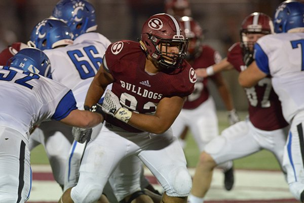 Springdale defensive lineman Isaiah Nichols breaks through the line of scrimmage during a game against Conway on Friday, Sept. 1, 2017, in Springdale.