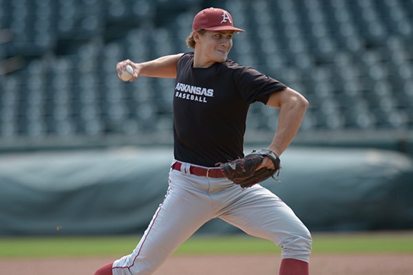 Arkansas pitcher Jake Reindl throws during practice Tuesday, Sept. 5, 2017, in Fayetteville.