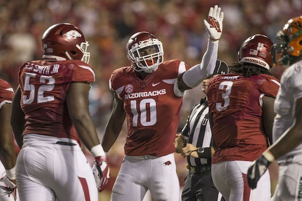 Randy Ramsey (10), Arkansas linebacker, congratulates defensive lineman McTelvin Agim (3) after a stop in the second quarter against Florida A&M Thursday, Aug. 31, 2017, during the game at War Memorial Stadium in Little Rock.