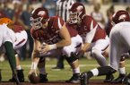 Arkansas quarterback Austin Allen (behind) prepares to take the snap from center Frank Ragnow during a game against Florida A&M on Thursday, Aug. 31, 2017, in Little Rock.