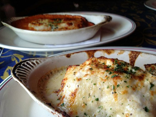 entrees-at-cafe-prego-include-a-seafood-lasagna-special-foreground-and-the-regular-menu-item-canneloni-rosario-background