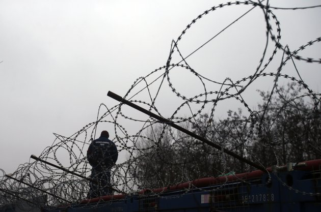 file-in-this-file-photo-dated-wednesday-feb-8-2017-a-hungarian-police-officer-stands-guard-at-serbias-border-with-hungary-near-a-makeshift-camp-for-migrants-in-horgos-serbia-the-european-court-of-justice-on-wednesday-sept6-2017-rejected-efforts-by-hungary-and-slovakia-to-stay-out-of-a-european-union-scheme-to-relocate-refugees-ap-photodarko-vojinovic-file