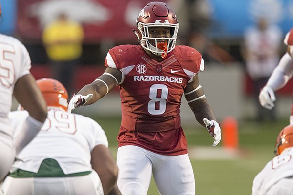 Arkansas linebacker De'Jon Harris lines up for a play during a game against Florida A&M on Thursday, Aug. 31, 2017, in Little Rock.