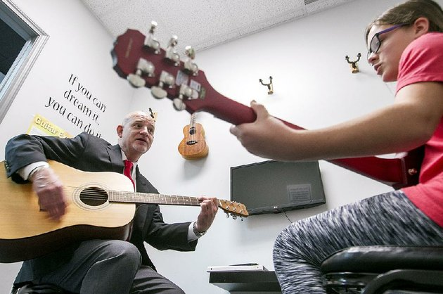jim-skelton-works-with-student-alayna-whited-on-thursday-during-one-of-her-vocal-and-guitar-lessons-at-his-music-studio-in-conway-skelton-owner-and-director-of-the-conway-institute-of-music-received-the-national-music-studio-of-the-year-award-during-a-ceremony-thursday