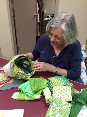 NWA Democrat-Gazette/BECCA MARTIN-BROWN Quilter Jan Murray Brown shows off one of her scrap baskets, a resource for finding the perfect piece of fabric for a design.