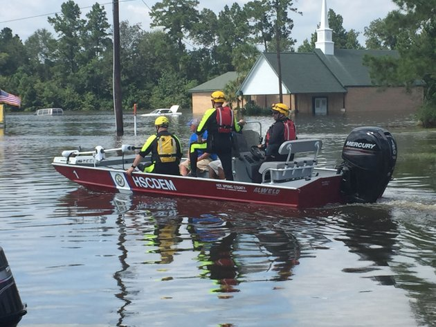 members-of-arkansas-task-force-one-and-arkansas-game-and-fish-commission-drive-a-boat-on-the-water-above-the-streets-of-kountze-texas-the-crews-worked-to-transport-people-and-supplies-last-week
