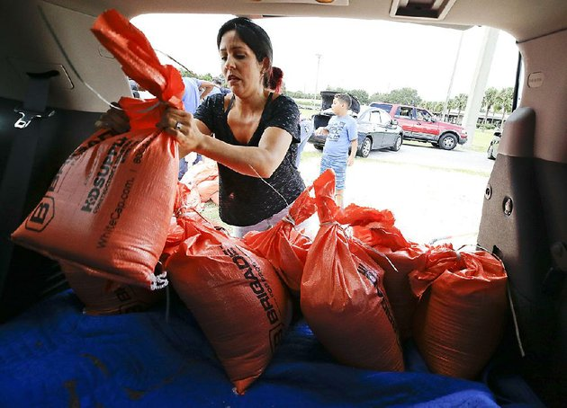 lilimar-garcia-loads-sandbags-in-her-vehicle-friday-in-orlando-fla-ahead-of-the-arrival-of-hurricane-irma-lines-stretched-for-miles-and-people-waited-several-hours-to-get-the-sandbags