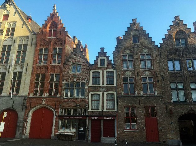rows-of-gilded-houses-some-of-which-date-to-the-16th-century-line-streets-in-bruges-belgium-the-city-escaped-damage-during-the-world-wars-and-looks-much-as-it-did-centuries-ago