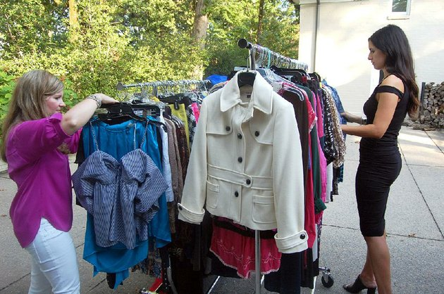 tiffany-robinson-business-manager-for-barbarajean-ltd-and-store-buyer-angela-strauss-sort-new-and-gently-used-clothing-to-be-sold-at-the-fourth-annual-pop-up-shop-to-be-held-friday-and-saturday-as-a-benefit-for-women-and-children-first-early-birds-will-have-the-chance-to-attend-the-preview-party-thursday