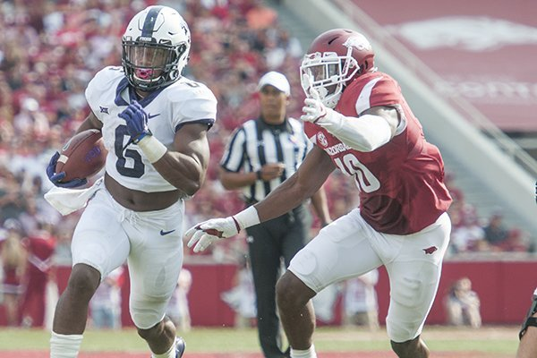 TCU running back Darius Anderson runs past Arkansas linebacker Randy Ramsey during a game Saturday, Sept. 9, 2017, in Fayetteville.