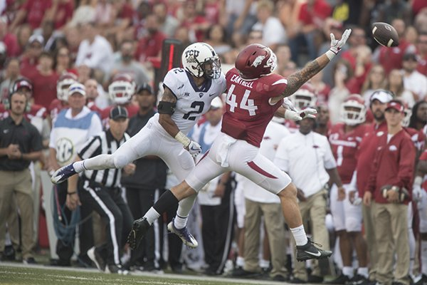 Arkansas tight end Austin Cantrell (44) reaches for an overthrown pass during a game against TCU on Saturday, Sept. 9, 2017, in Fayetteville.