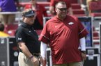 TCU coach Gary Patterson, left, and Arkansas coach Bret Bielema talk before an NCAA college football game football game in Fayetteville, Ark., Saturday, Sept. 9 2017. (AP Photo/Michael Woods)