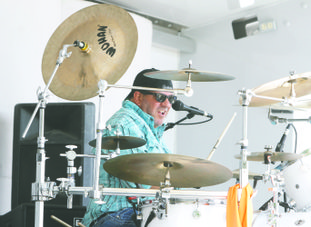 Drums: Paul Baumgardner of the band Aces Wild performs during the SouthArk Outdoor Expo.
