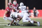 Arkansas linebacker Grant Morgan chases TCU receiver Dylan Thomas during a game Saturday, Sept. 9, 2017, in Fayetteville.