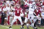 Austin Allen (8) of Razobacks attempts to pass the ball as Ridwan Issahaku (31) trys to block the pass at Donald W. Reynolds Razorback Stadium on Saturday, September 9, 2017.