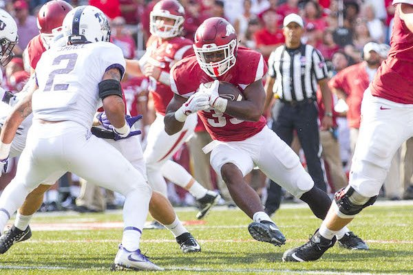 Arkansas' David Williams (33) runs the ball against TCU at Donald W. Reynolds Razorback Stadium on Saturday, September 9, 2017.