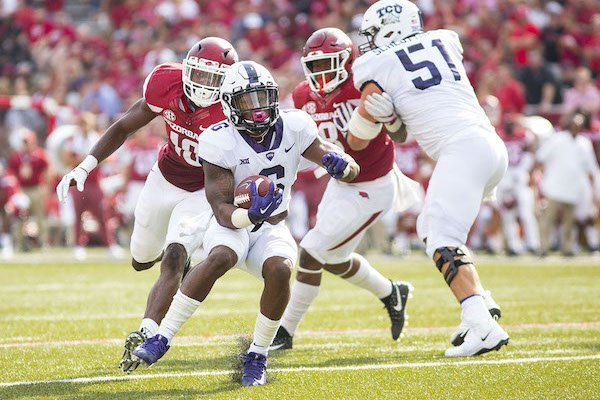 TCU Horned Frogs vs Arkansas Razorbacks –Darius Anderson(6) running the ball up the field as Randy Ramsey (10) tries to catch him from behind at Donald W. Reynolds Razorback Stadium, University of Arkansas, Fayetteville, AR, on Saturday, September 9, 2017.