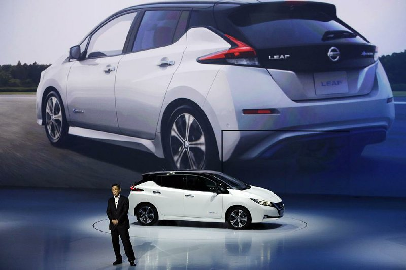 Nissan President And Chief Executive Officer Hiroto Saikawa Unveils The Company S New Leaf Electric Vehicle During World Premiere In Chiba Near Tokyo