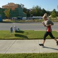 A runner makes her way along Salem Road on Saturday past houses being built south of Wedington Drive...