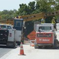 Fayetteville Transportation Division workers assemble a retaining wall Thursday along College Avenue...