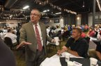 Jeff Long, University of Arkansas, Fayetteville, athletic director, chats Wednesday Sept. 6 2017 after his talk to the NWA Touchdown Club.