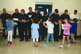 Thanks: During a Patriot Day assembly, Northwest Elementary students thank local first responders with handwritten notes and drawings.