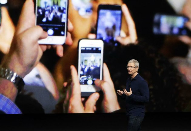 apple-inc-ceo-tim-cook-describes-the-functions-of-the-iphone-7-during-a-product-release-event-in-this-september-2016-photo-two-apple-focused-blogs-said-over-the-weekend-that-apple-will-release-three-phones-today-the-iphone-8-iphone-8-plus-and-iphone-x