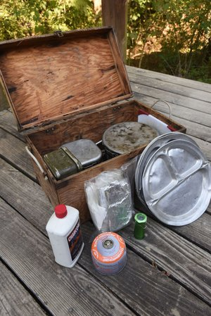 A camp box that stays packed with cook kit, stove and other items saves time when preparing for a trip.