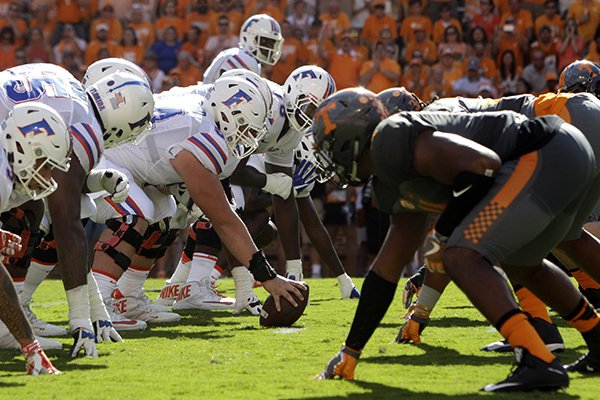 In this Sept. 24, 2016, file photo, Florida, left, and Tennessee NCAA college football teams line up during a game in Knoxville, Tenn. (AP Photo/Wade Payne, File)
