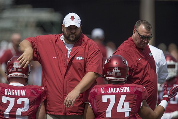 Arkansas offensive line coach Kurt Anderson, left, and head coach Bret Bielema talk with players prior to a game against TCU on Saturday, Sept. 9, 2017, in Fayetteville.