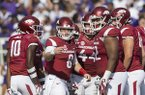 Arkansas quarterback Austin Allen (8) looks toward the sideline while huddling with teammates during a game against TCU on Saturday, Sept. 9, 2017, in Fayetteville.