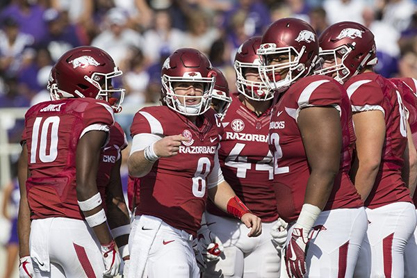 arkansas-quarterback-austin-allen-8-looks-toward-the-sideline-while-huddling-with-teammates-during-a-game-against-tcu-on-saturday-sept-9-2017-in-fayetteville