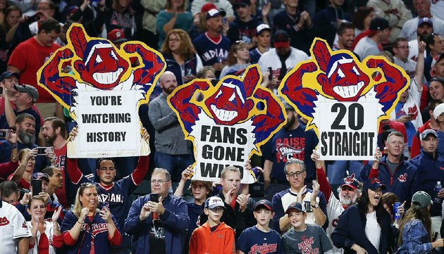 cleveland-indians-fans-celebrate-after-their-teams-2-0-victory-over-the-detroit-tigers-on-tuesday-night-the-indians-have-won-20-games-in-a-row-which-is-tied-for-the-third-longest-winning-streak-ever-in-the-major-leagues