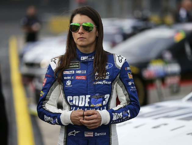 in-this-thursday-may-25-2017-file-photo-danica-patrick-stands-by-her-car-before-qualifying-for-sundays-nascar-cup-series-auto-race-at-charlotte-motor-speedway-in-concord-nc