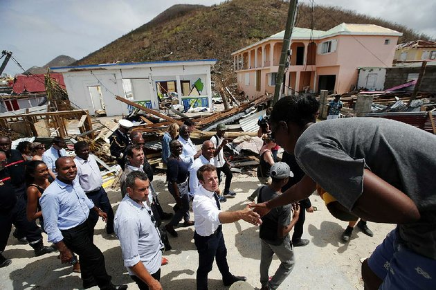 french-president-emmanuel-macron-center-greets-residents-tuesday-during-a-tour-of-the-storm-ravaged-island-of-st-martin-he-pledged-a-fast-recovery-for-the-island