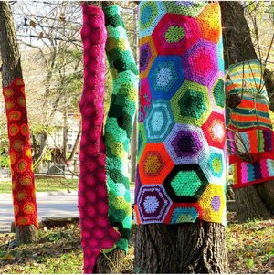 The afghans that wrapped these trees in Eureka Springs' North Main Music Park were the work of local artist Gina Gallina, who saw they were missing Aug. 31.