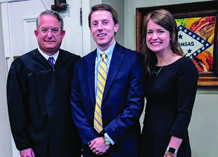 Shepherd, center, was sworn in as the new prosecutor for the 13th Judicial District, by Fourth Division Circuit Judge Robin Carroll. Shepherd's wife, Molly, was one of several family members to attend the ceremony Tuesday.