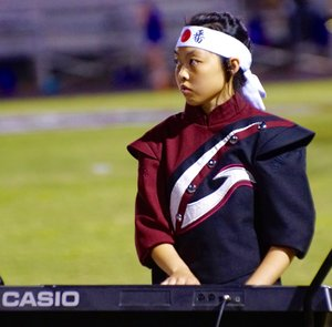 Photo by Randy Moll Alexia Lo plays the keyboard during the halftime performance of the Gentry High School marching band in Pioneer Stadium on Friday, Sept. 1.