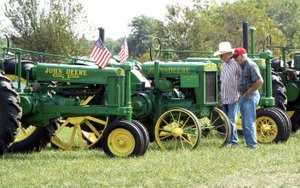 Photo by Randy Moll Larry Keaton and Kenneth Christerson of Anderson, Mo., were involved in tractor talk at the fall show of the Tired Iron of the Ozarks on Friday, Sept. 8, 2017. The featured tractor at this year's show was the John Deere and there were plenty of the old tractors to show off. The antique engine and tractor show ran through Sunday.