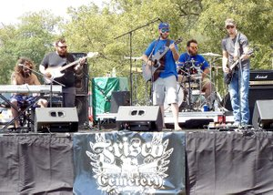 Photo by Randy Moll Frisco Cemetery took to the stage Saturday afternoon to kick off the Saturday festivities at the Cool Water Music Festival near Gravette.