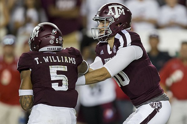 Texas A&M quarterback Jake Hubenak (10) hands the ball off to running back Trayveon Williams (5) during the third quarter of an NCAA college football game against Nicholls State Saturday, Sept. 9, 2017, in College Station, Texas. Texas A&M won 24-14. (AP Photo/Sam Craft)