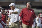 Arkansas coach Bret Bielema, right, and defensive coordinator Paul Rhoads talk to players during a game against TCU on Saturday, Sept. 9, 2017, in Fayetteville.