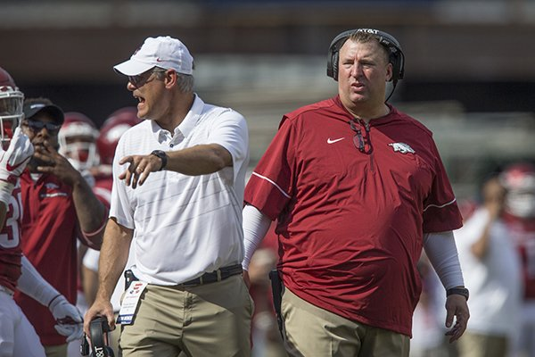 arkansas-coach-bret-bielema-right-and-defensive-coordinator-paul-rhoads-talk-to-players-during-a-game-against-tcu-on-saturday-sept-9-2017-in-fayetteville