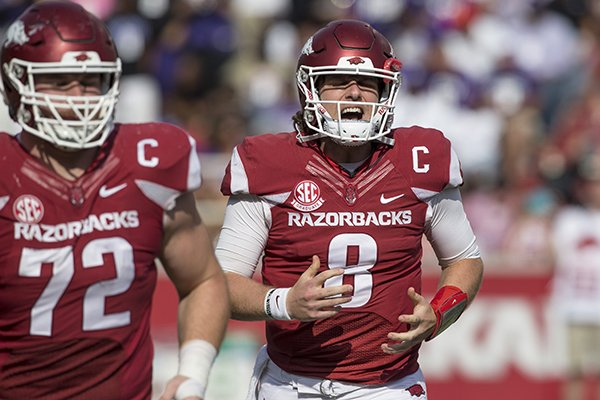 Arkansas quarterback Austin Allen (8) runs off the field during a game against TCU on Saturday, Sept. 9, 2017, in Fayetteville.