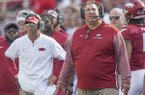 Arkansas coach Bret Bielema (right) and offensive coordinator Dan Enos react during a game against TCU on Saturday, Sept. 9, 2017, in Fayetteville.