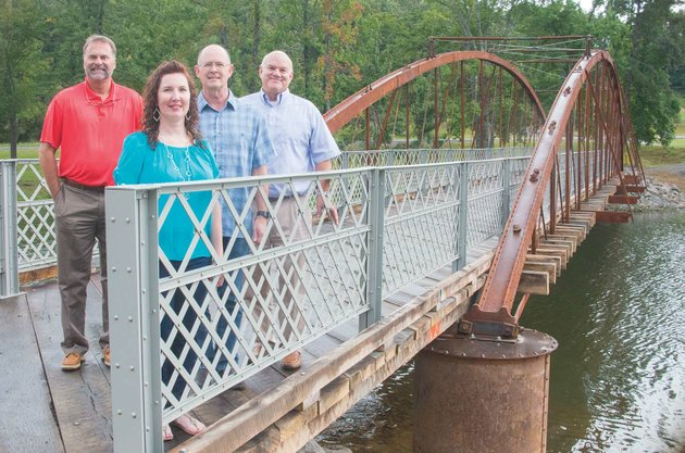 the-city-of-conway-and-the-faulkner-county-historical-society-will-hold-a-dedication-ceremony-for-the-refurbished-springfield-des-arc-bridge-at-10-am-sept-23-at-beaverfork-lake-park-among-the-participants-in-the-ceremony-will-be-faulkner-county-historical-society-president-rebekah-bilderback-front-and-back-row-from-left-conway-mayor-bart-castleberry-kenneth-barnes-faulkner-county-historical-society-member-and-jack-bell-chief-of-staff-for-the-city-of-conway